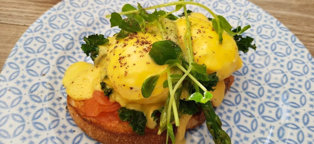 Ristretto & Co Eggs Benedict with Salmon, kale, in house hollandaise sauce on a nicely toasted piece of bread
