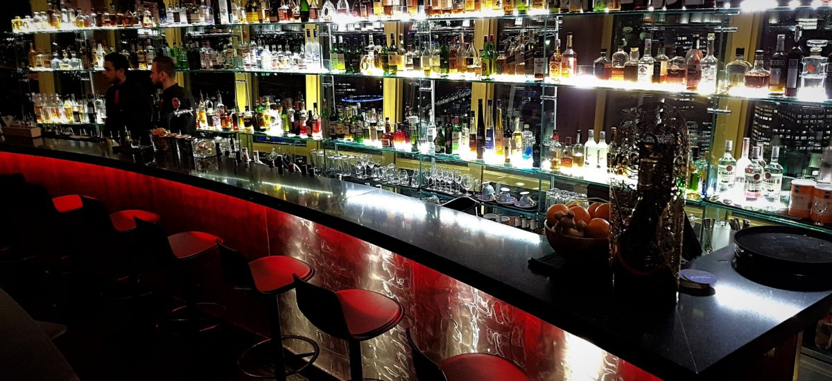 360 Bar and Dining show casing a selection of whiskey and assortment of alcohol. Great lighting and ambiance with bartenders all ready to go!